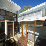 Cape Cod transformed into sustainable architect designed home - rear deck