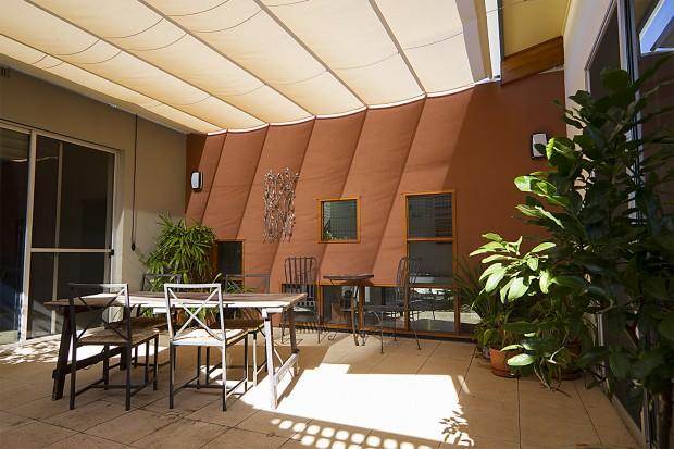 Operable shade, internal courtyard