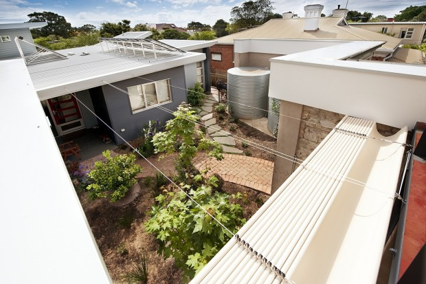 Courtyard, bluestone walls, villa, solar access, reverse block veneer, solar hot water, hydronic heating, thermal mass, climate wizard, evaporative cooling, rammed earth, polished concrete floors, sustainable